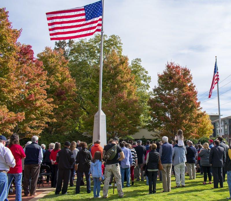 Auburn residents gathered around the flag at the 2019 Veterans Day Ceremony on Nov. 11, 2019.