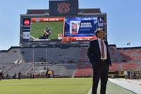 Gus Malzahn walks the field prior to a NCAA college football game, Saturday, Oct. 1, 2016, in Auburn, Ala.