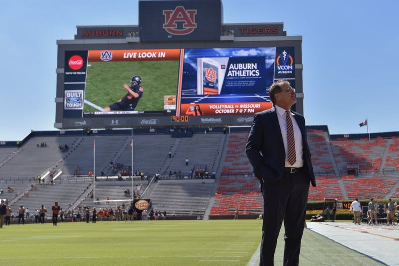 Gus Malzahn walks the field prior to a NCAA college football game, Saturday, Oct. 1, 2016, in Auburn, Ala.