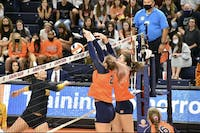 Oct. 16, 2021; Auburn, AL, USA; Tatum Shipes (21, left) and Val Green (16, right) block a shot in a match between Auburn and Missouri in the Auburn Arena.