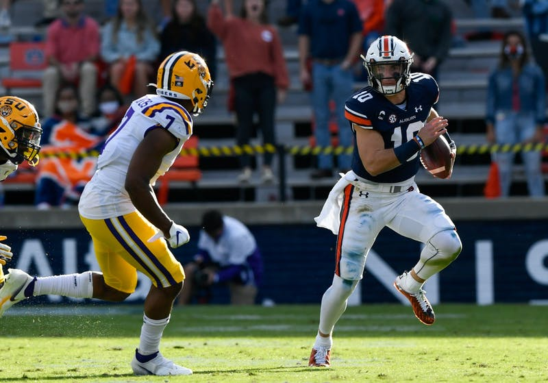 Oct 3, 2020; Auburn AL, USA; Bo Nix (10) rushes to his left for the first down during the game between Auburn and LSU at Jordan Hare Stadium. Mandatory Credit: Todd Van Emst/AU Athletics