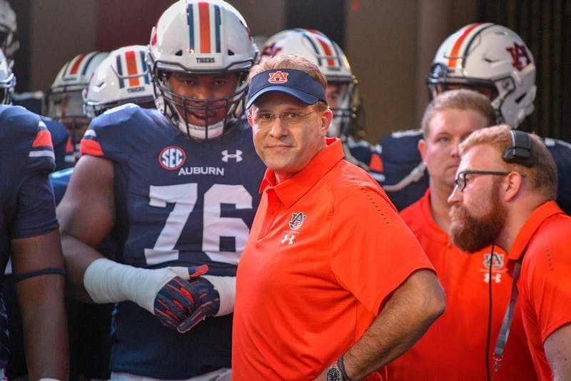 Coach Gus Malzahn prepares to run onto the field prior to Auburn vs. Arkansas on Saturday, Sept. 22, 2018, in Auburn, Ala.