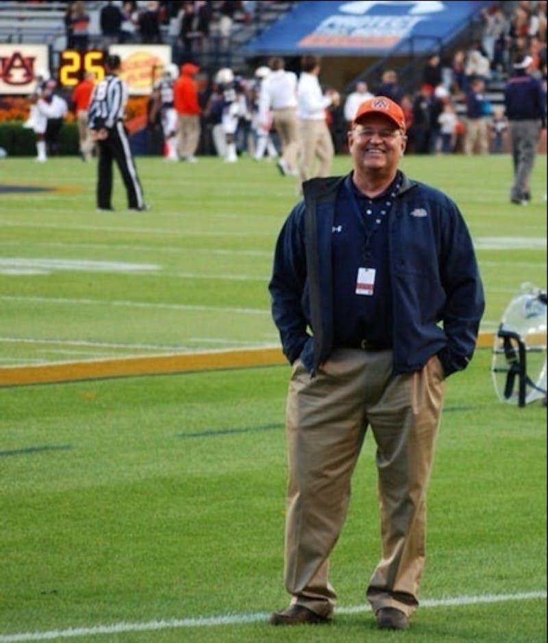 Dr. Jim Phillips Jr. stands on the football field in Jordan-Hare Stadium.