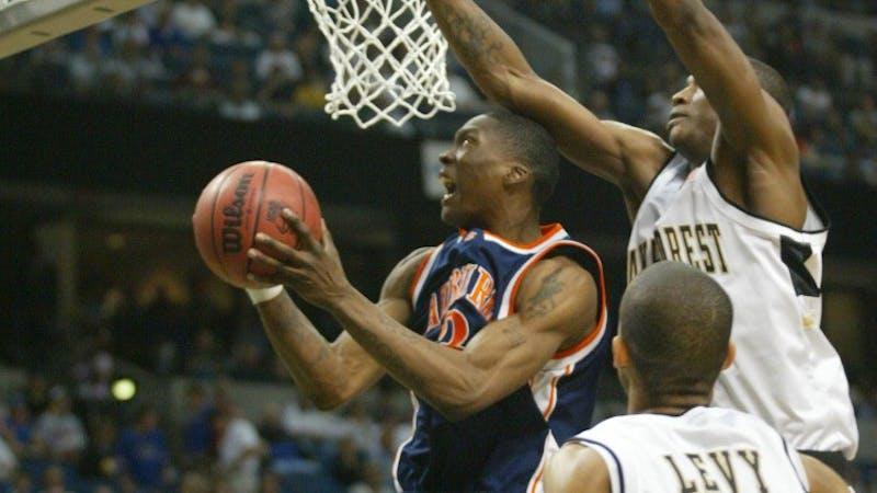 Marquis Daniels (3) during the 2003 Auburn basketball season. Via Auburn Athletics.