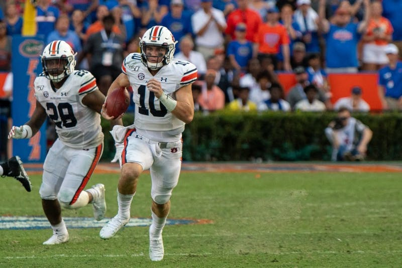 Bo Nix (10) runs with the ball during Auburn vs. Florida, on Saturday, Oct. 5, 2019, in Gainesville, Fla.