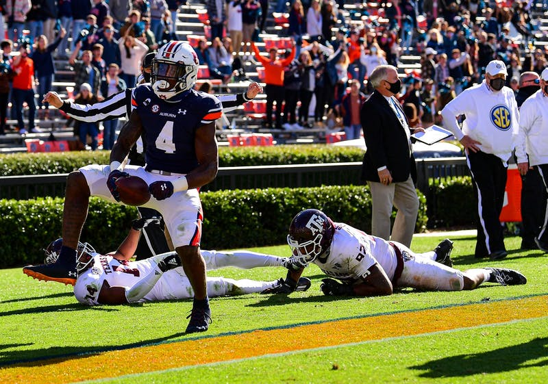 Tank Bigsby runs the ball during the game between Auburn and Texas A&M at Jordan Hare Stadium on Dec 5, 2020; Auburn AL, USA. Photo via: Shanna Lockwood/AU Athletics