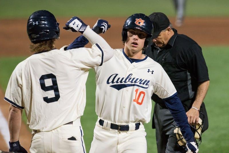 Edouard Julien (10) celebrates a home run with Luke Jarvis (9)during Auburn baseball vs. Missouri at Plainsman Park in Auburn, Ala. on Friday, March 30, 2018.