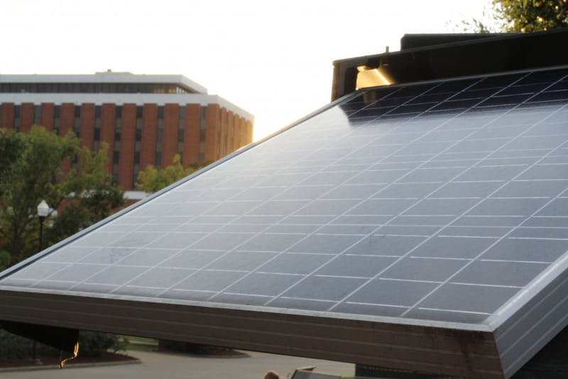 A solar panel collects a day's final rays of light outside Foy Union Hall.