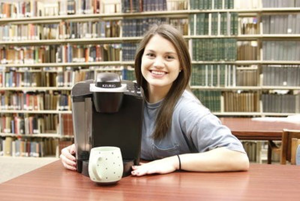 Keurig Girl getting attention from carrying coffee machine