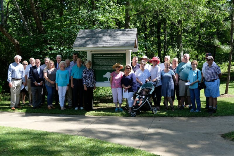 Group poses for photo at the George Bengtson Tree Trail Dedication on June 19, 2018 in Auburn, Ala.