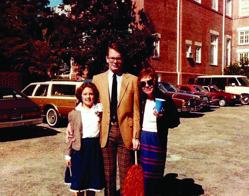 Kristen, Mark and Betty Qualls attend the Auburn Homecoming football game in 1983.