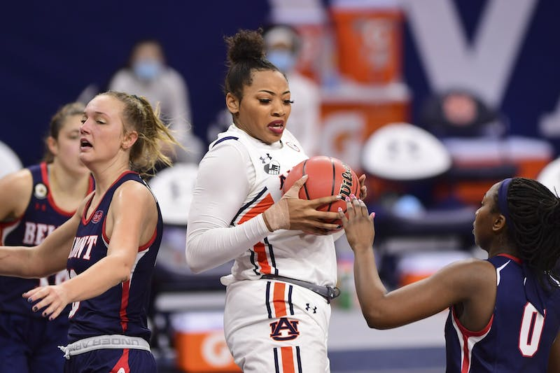 Dec 20, 2020; Auburn, AL, USA; Auburn Tigers forward Unique Thompson (20) reaches for a rebound during the game between Auburn and Belmont at Auburn Arena. Mandatory Credit: Shanna Lockwood/AU Athletics
