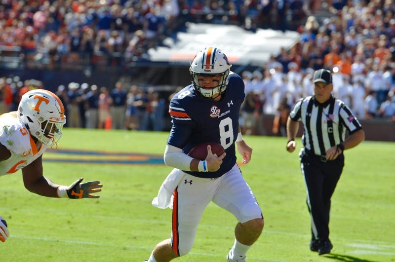 Jarrett Stidham (8) runs the ball during Auburn Football vs. Tennessee on Saturday, Oct. 13, 2018 in Auburn, Ala.