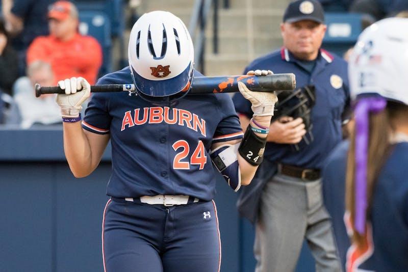 Kendall Veach (24) returns from the plate during Auburn softball vs. Arkansas on Saturday, April 21, 2018, in Auburn, Ala.