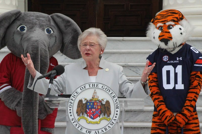 Gov. Kay Ivey speaks on the Capitol steps during the 25th Auburn-Alabama food drive commemoration on Oct. 1, 2018, in Montgomery, Ala.