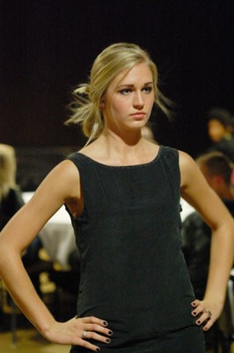 Gilda Osborn, sophomore in prenursing, walks the runway during the Couture for the Cure fashion show Thursday. (Charlie Timberlake / ASSISTANT PHOTO EDITOR)