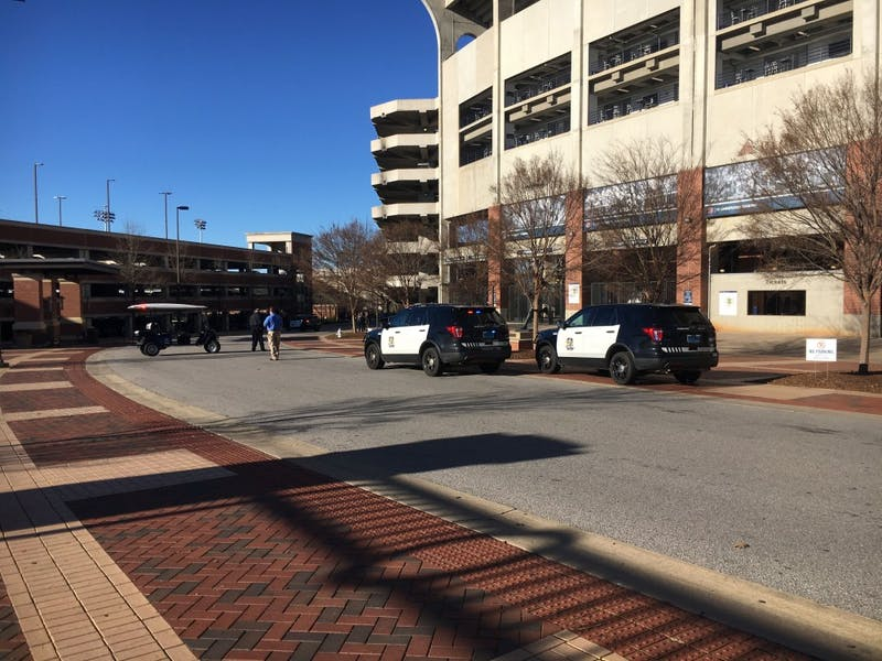 Police investigate a suspicious package near the transit hub on Heisman Drive.