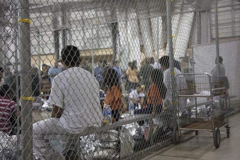 In this photo provided by U.S. Customs and Border Protection, people who've been taken into custody related to cases of illegal entry into the United States, sit in one of the cages at a facility in McAllen, Texas, on June 17, 2018. (U.S. Customs and Border Protection's Rio Grande Valley Sector/TNS)