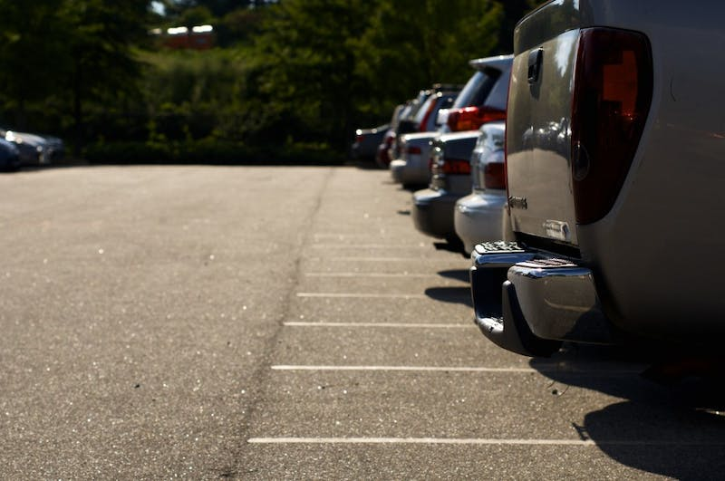 Cars fill parking spaces in Resident Overflow parking lot at Auburn University on Tuesday, Aug. 22, 2017 in Auburn, Ala.