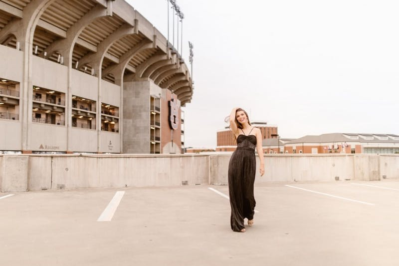 Paige Purvis, senior in apparel merchandising, poses in Rent the Runway gown in Auburn, Ala.