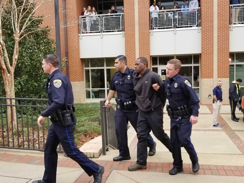 Police arrest a man near the Student Center on Jan. 24, 2019.