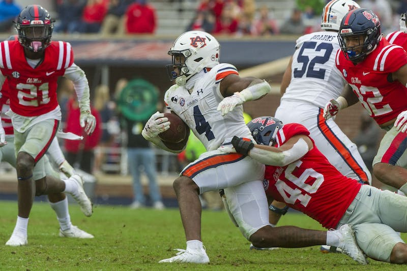 Mississippi Rebels linebacker MoMo Sanogo (46) tackles Auburn Tigers running back Tank Bigsby (4) during the second half at Vaught-Hemingway Stadium on Oct 24, 2020; Oxford, Mississippi, USA. Photo via: Justin Ford-USA TODAY Sports