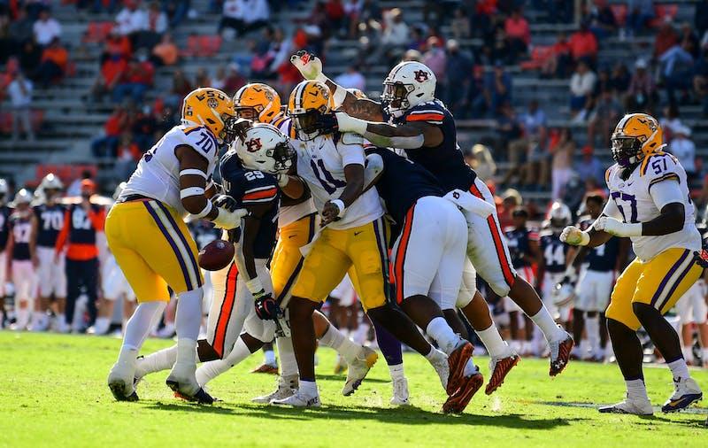 Derick Hall (29) forces fumble during the game between Auburn and LSU at Jordan Hare Stadium on Oct 31, 2020; Auburn AL, USA. Photo via: Shanna Lockwood/AU Athletics