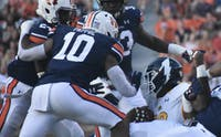 Owen Pappoe (10) and a host of tacklers during Auburn vs. Kent State on Sept. 14, 2019, in Auburn, Ala.