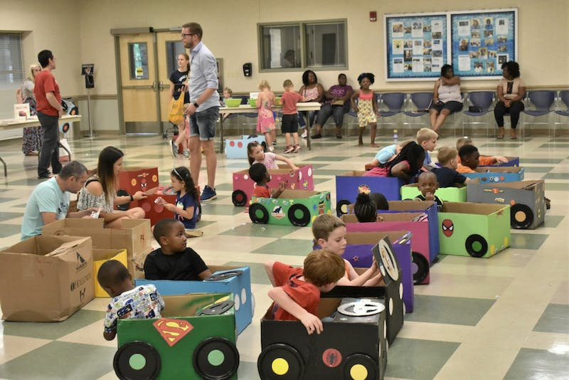 """Children sit in their new """"cars"""" at the drive-inFriday, June 15, 2018 in Opelika, Ala."""