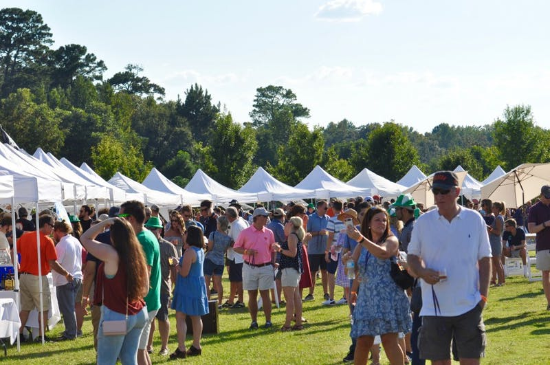 Guests crowd around tents for Oktoberfest on Saturday, Oct. 6, 2018 in Auburn, Ala.