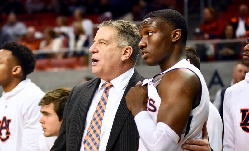 Head coach Bruce Pearl talks with Auburn guard Jared Harper (1) during Auburn Men's Basketball vs. Missouri on Wednesday, Jan. 30, 2019, in Auburn, Ala.