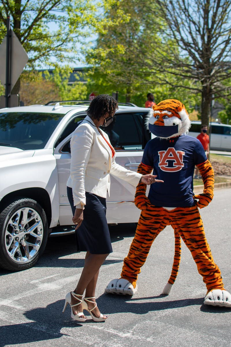Johnnie Harris the new Auburn Women's Basketball coach talks with Aubie prior to her formal introduction ceremony on Monday, April 5, 2021, in Auburn, Ala.