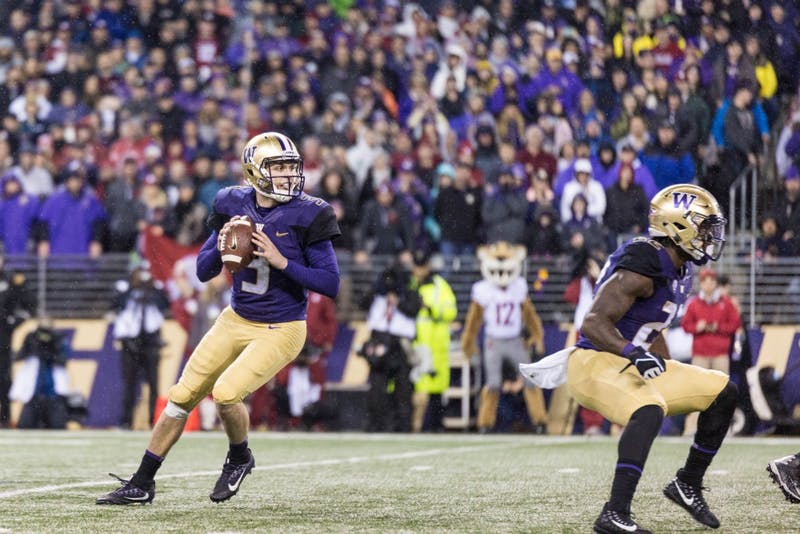Quarterback Jake Browning searches for the pass during the Apple Cup. Photo courtesy of the UW Daily sports desk.