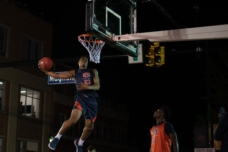 Isaac Okoro (23) goes for a dunk during Tipoff at Toomer's, on Thursday, Oct. 17, 2019, in Auburn, Ala.