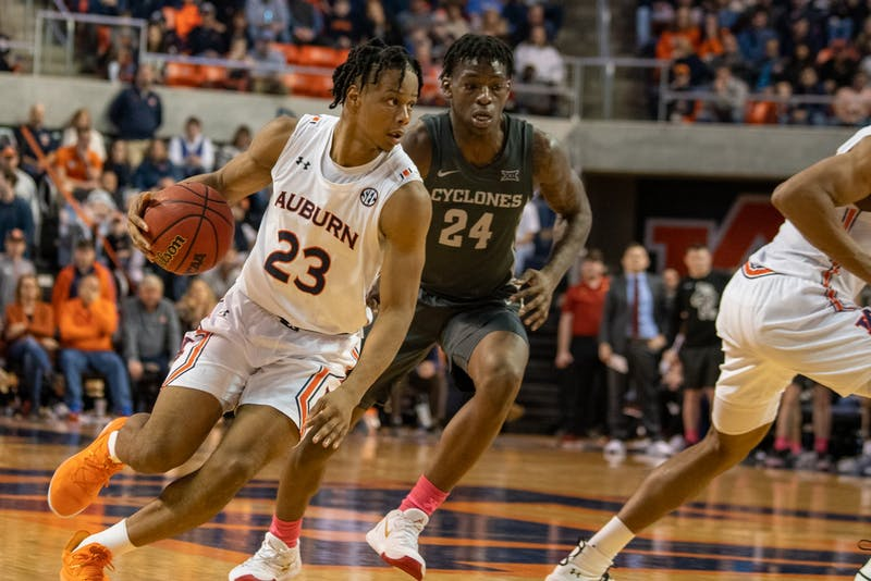 Issac Okoro (23) runs with the ball up the court during Auburn Men's Basketball vs. Iowa State on Sat, Jan. 25, 2020, in Auburn, Ala.