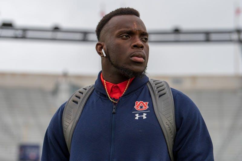 Deshaun Davis (57) walks the field prior to Auburn Football vs. Ole Miss on Saturday, Oct. 20, 2018, in Oxford, Miss.