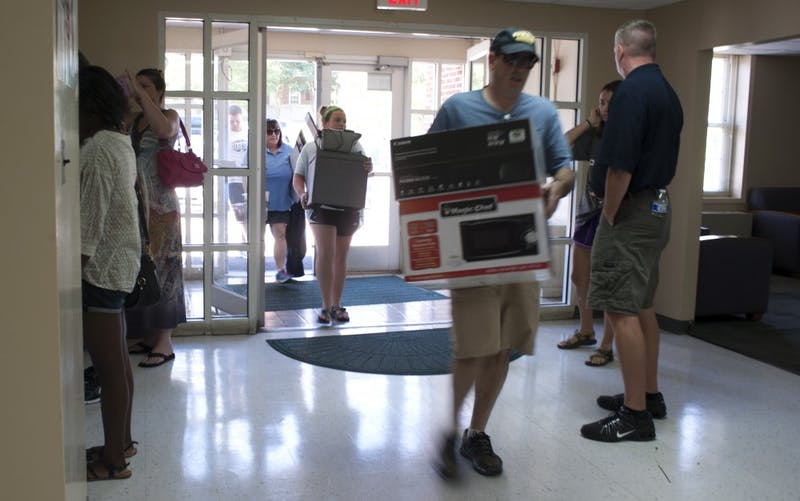 Parents assist students move into The Hill dorms on Thursday, August 13.