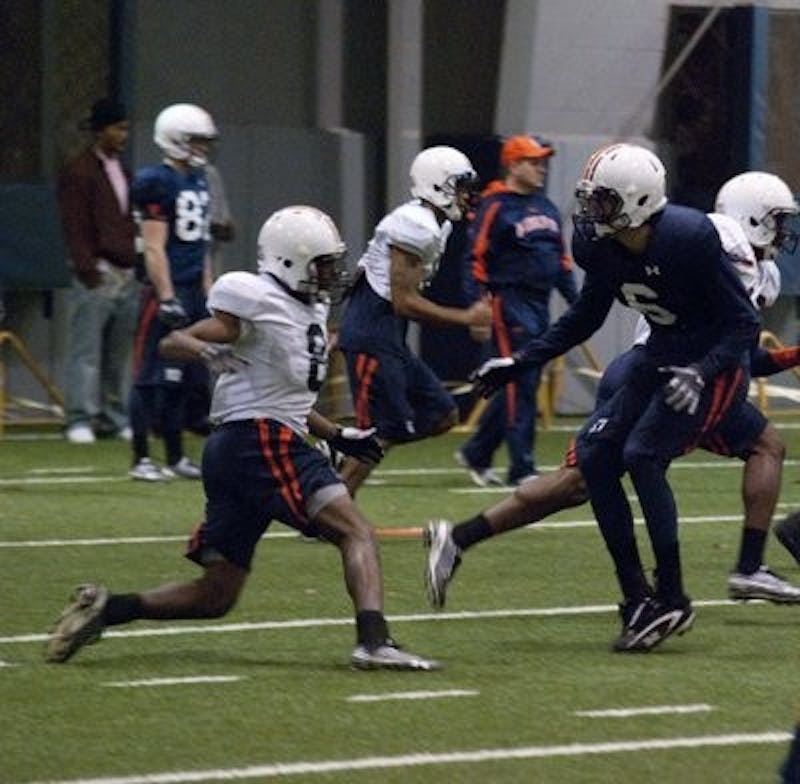 The Auburn University football team held its first practice in preparation for the Outback Bowl against the Northwestern University Wildcats.