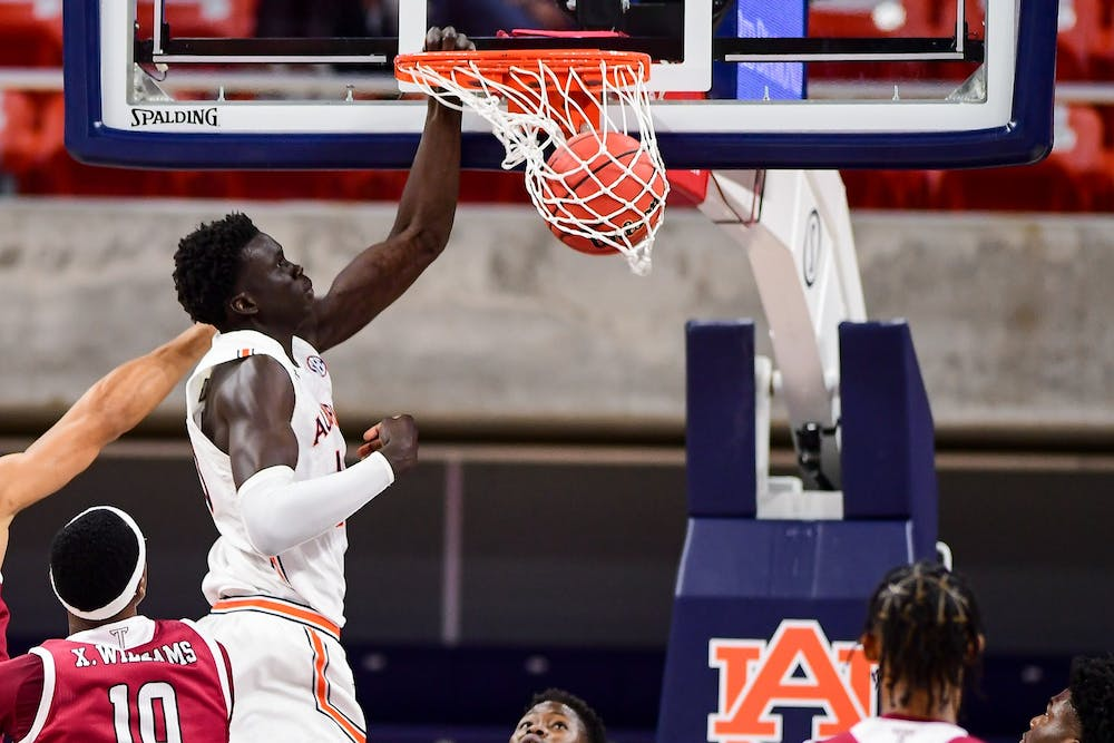 Behind dominant first half, Tigers rout Troy 77-41