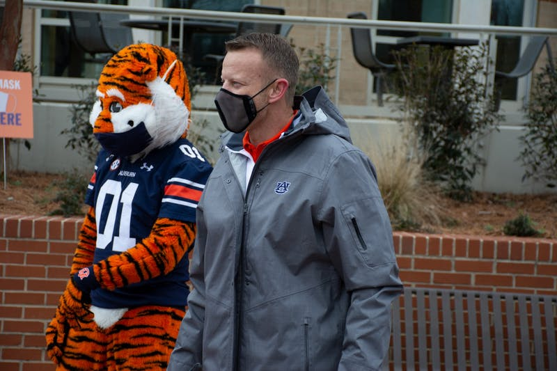 Head coach Bryan Harsin poses for a picture with Aubie on the Haley Concourse on Monday, Feb. 1, 2021, in Auburn, Ala.