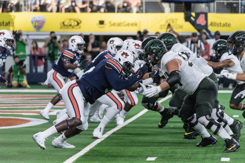 Auburn's defensive line attacks Oregon's offensive front during Auburn vs. Oregon on Aug. 31, 2019, in Arlington, Texas. Photo courtesy of The Glomerata.