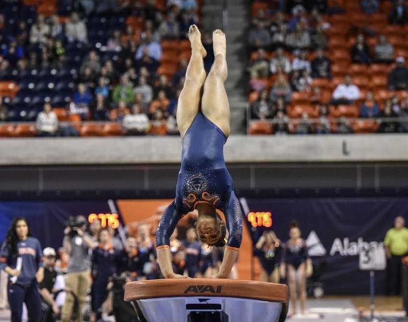 A'Miracal Phillips performs on vault during Auburn vs Arkansas gymnastics on Friday, Feb. 3, 2017, in Auburn, Ala.