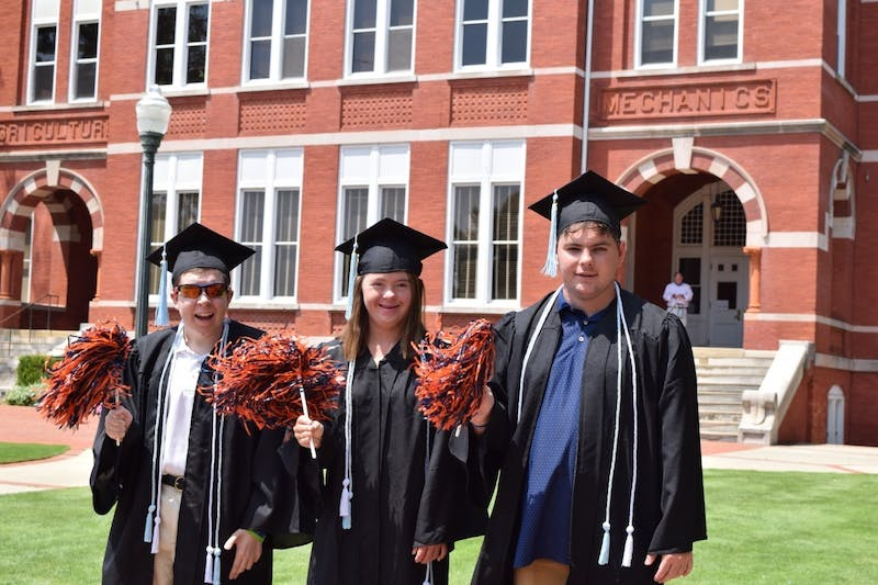 Bradely Basden (left), Anna Moates (middle) and Josh Greiner (right) celebrate their graduation from the EAGLES program.