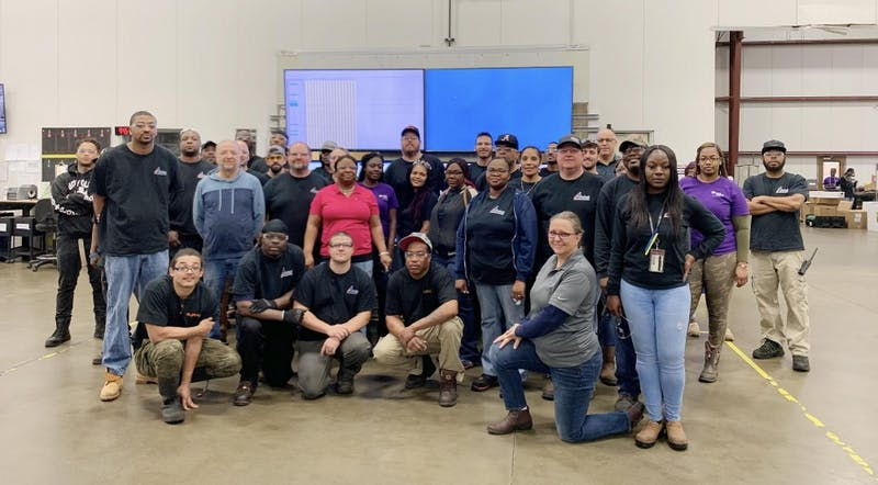ARKAL Automotive employees pose at the Auburn location.