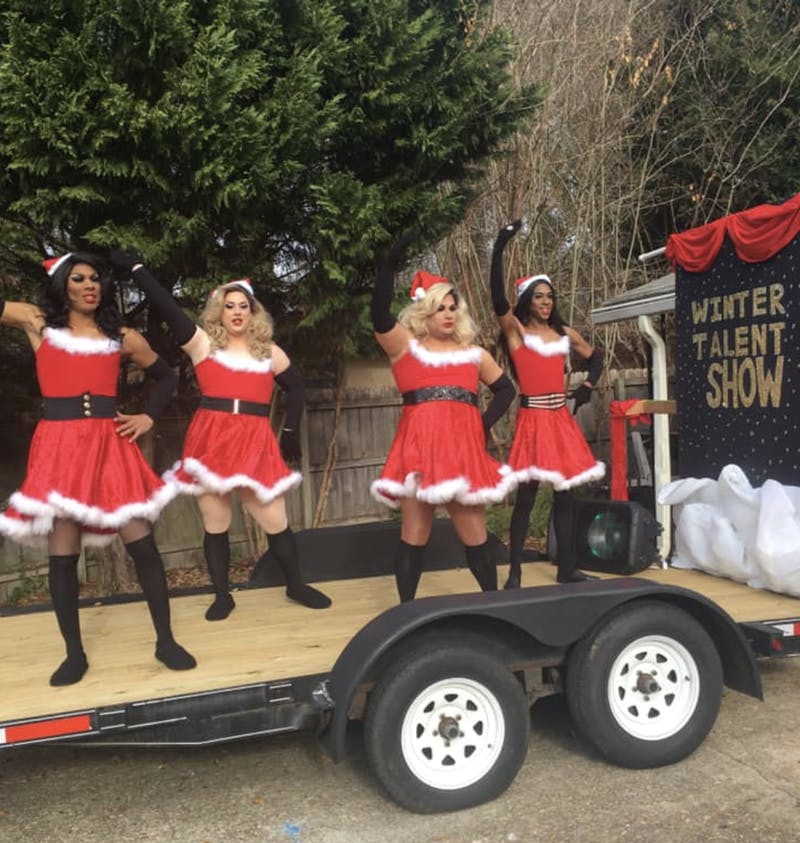 Drag Queens perform on the Pride on The Plains float at the Opelika Christmas Parade on Saturday, Dec. 7, 2019 in Opelika, Ala.