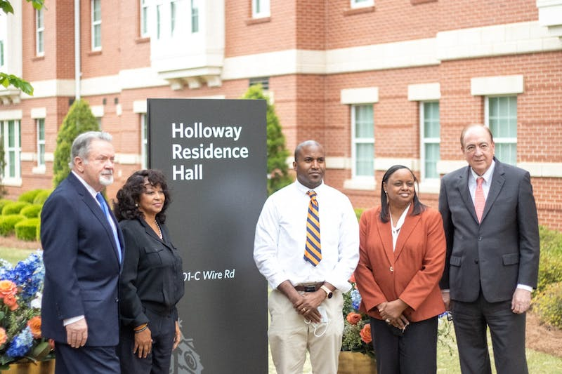 (From left to right): Auburn trustee James Pratt, Prichard, Ala. councilwoman Stephani Johnson-Norwood, Norman Vivians, Auburn trustee Elizabeth Huntley and Auburn University President Jay Gogue pose by a new sign dedicating Holloway Hall.