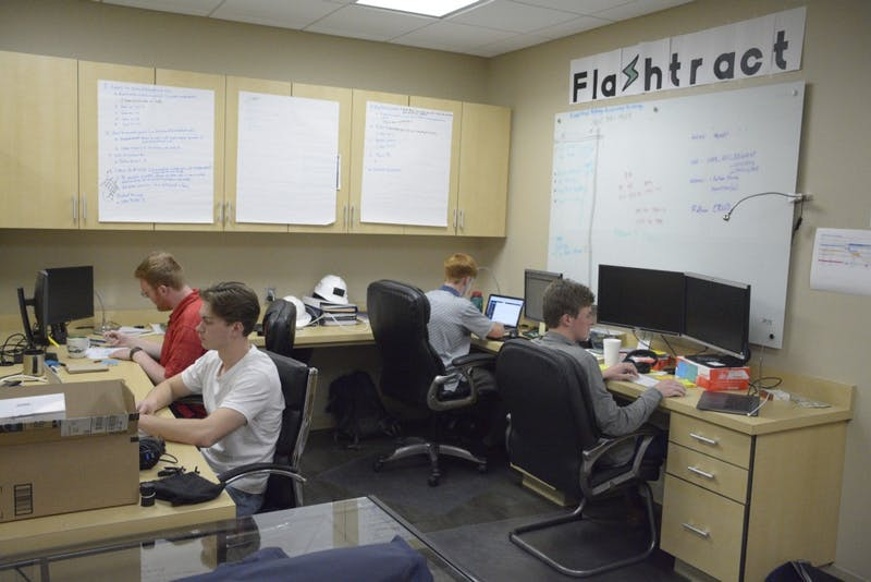 FlashTract team members work in their office at the Auburn Research Park on April 8, 2019.