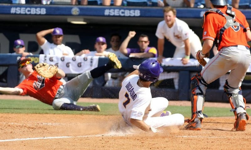 LSU scores at home plate. Photo via LSU Athletics/@LSUBaseball on Twitter.