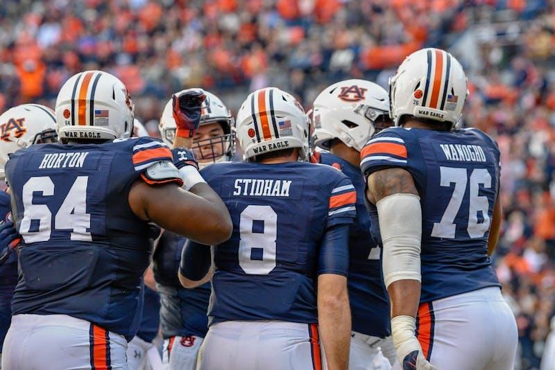 Jarrett Stidham (8) celebrates with his teammates during Auburn Football vs Liberty on Saturday,  Nov. 17, 2018, in Auburn, Ala.