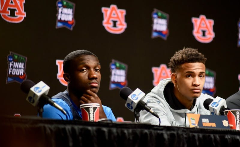 Jared Harper (1), Bryce Brown (2) and Coach Bruce Pearl answer questions during a press conference on Friday, April 5, 2019, in Minneapolis, Minn.